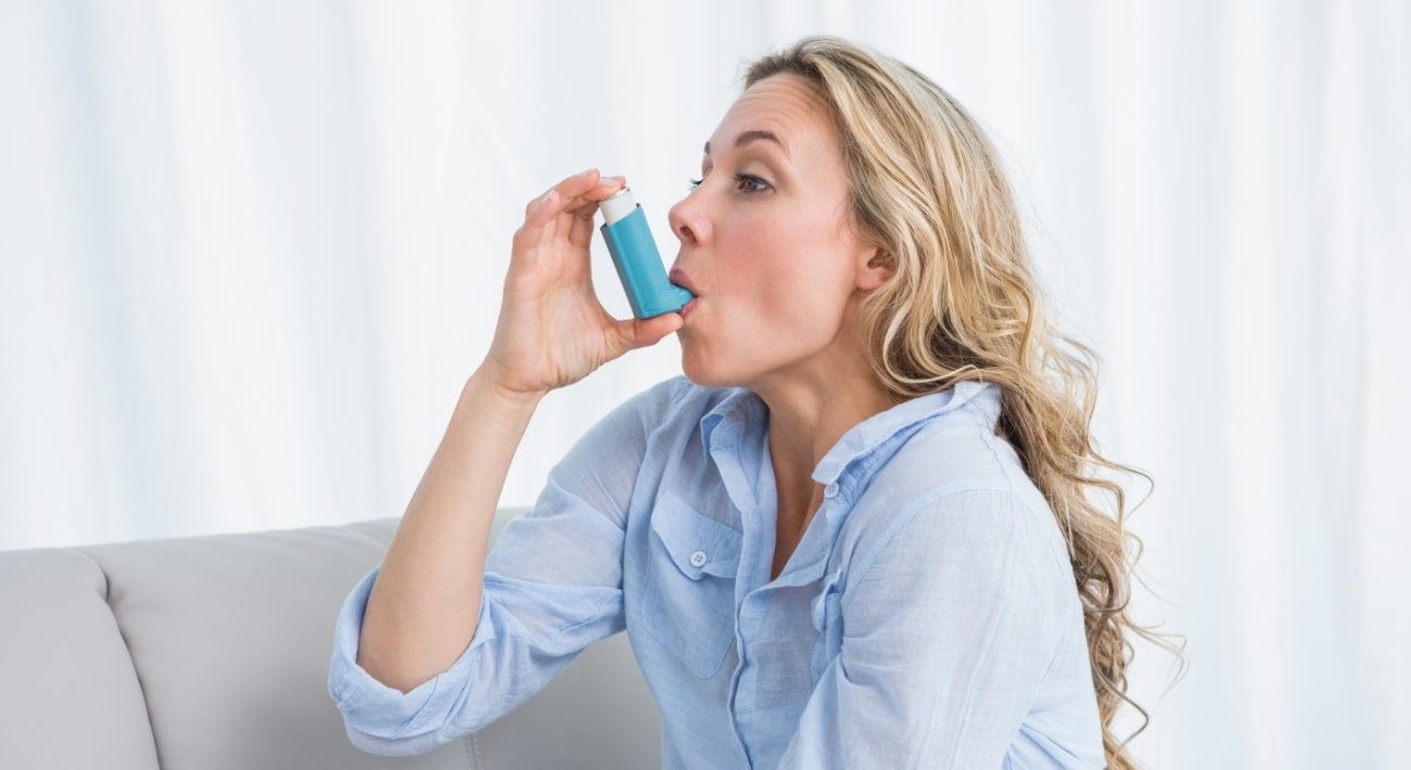 woman with asthma inhaler for relief